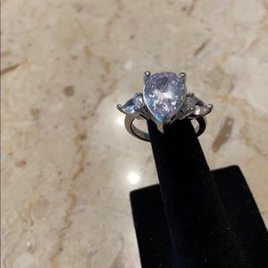 Silvertone solitaire large stone ring.